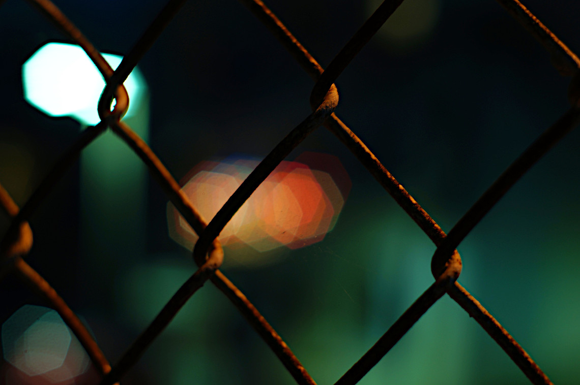 Night behind a fence